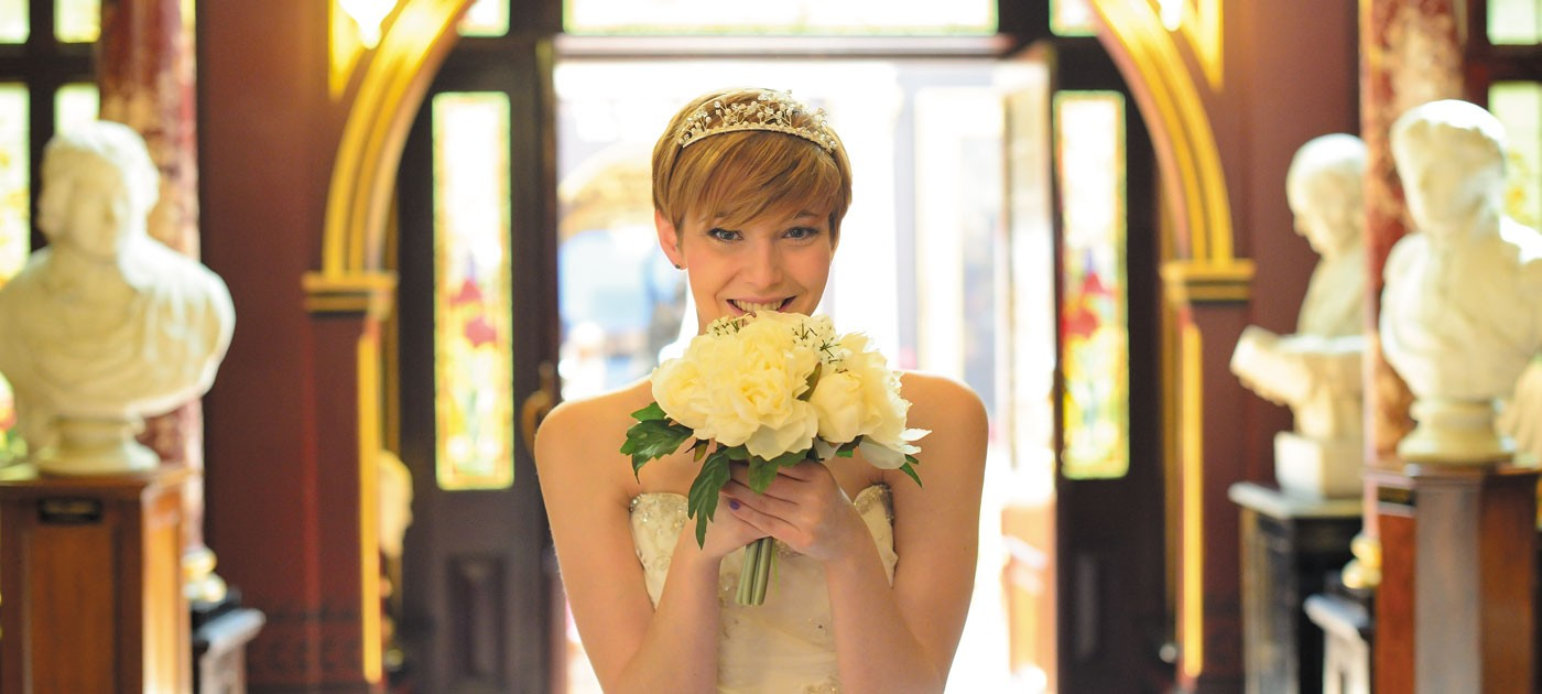 russell cotes weddings bride with flowers in main hall
