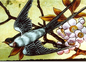 Stained glass of a Swallow flying